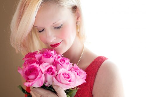 Woman Smelling Fragrant Roses
