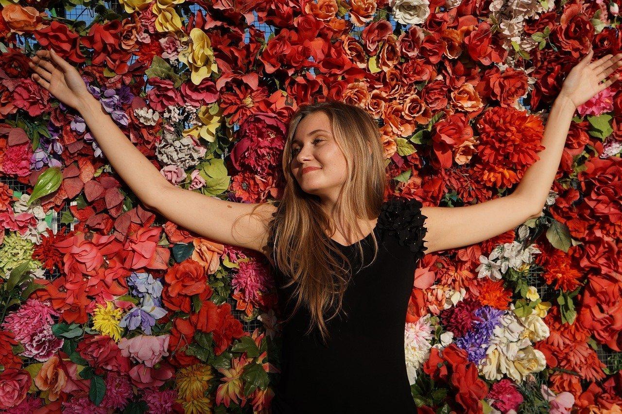 Lady Girl Basking in Flowers