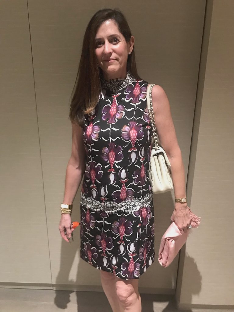 Woman In Orchid Pattern Floral Dress
