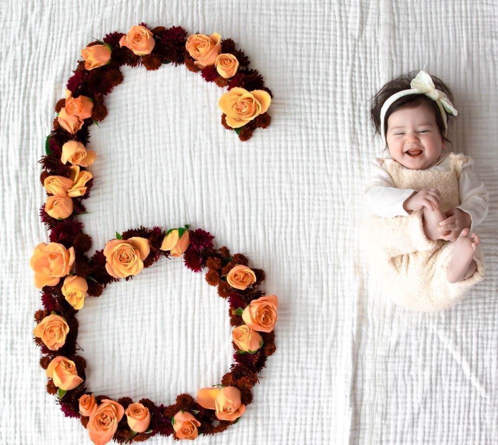 6 Month Old Girl With Orange Roses