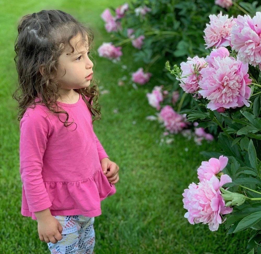 Little Girl Gardening Flowers