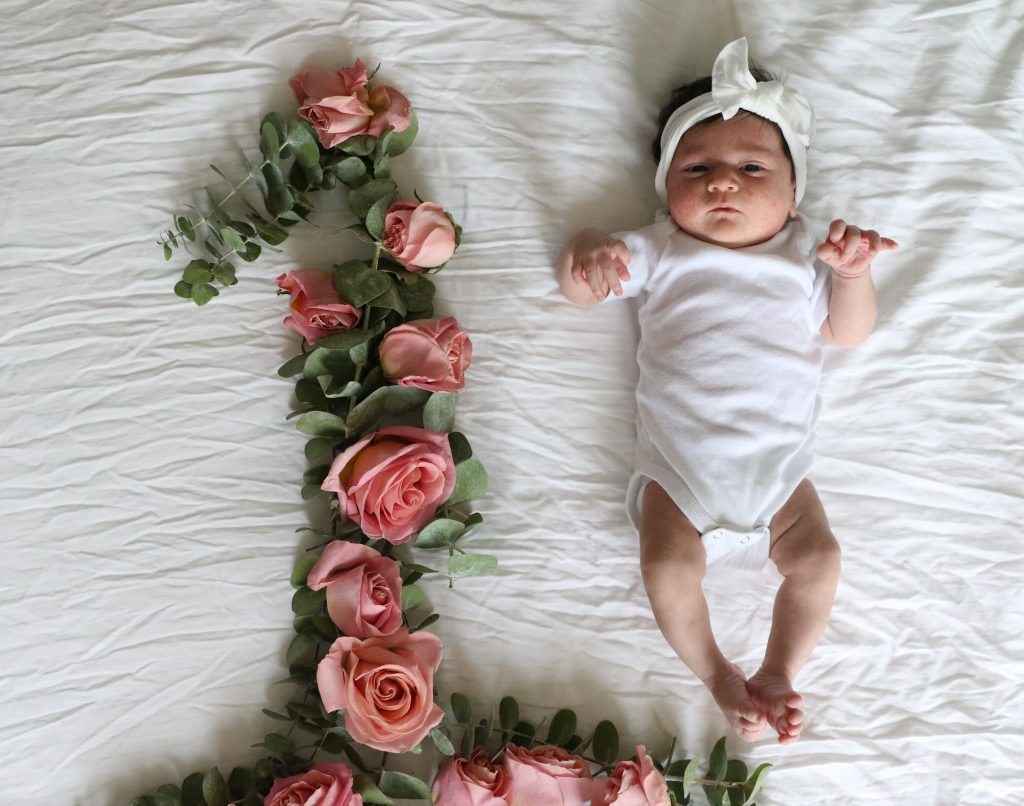 Pink Roses With One Year Old Baby