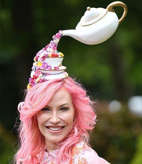 Alexa Wolman wears tea pot hat pouring flowers