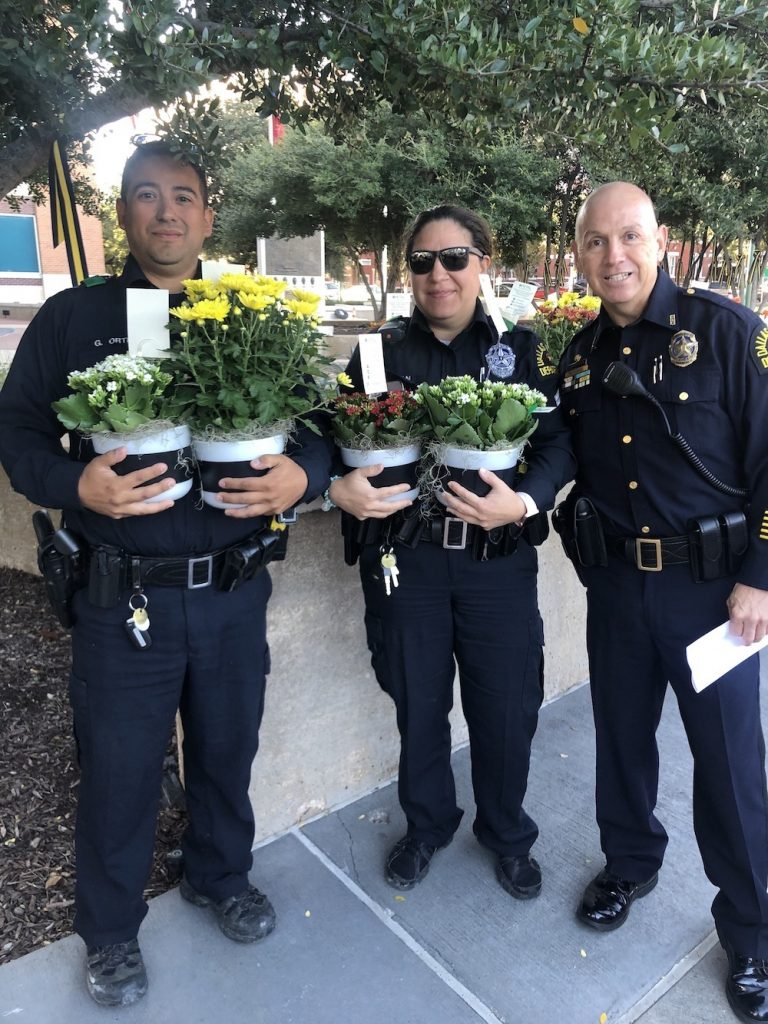 Dallas Police force passing out free flowers