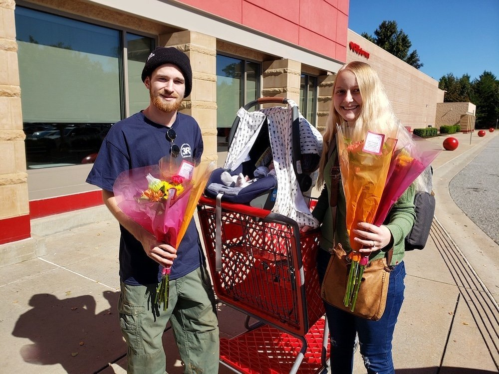 Young couple receive free flowers